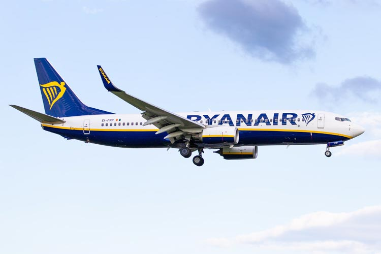 Ryanair aircraft against blue sky