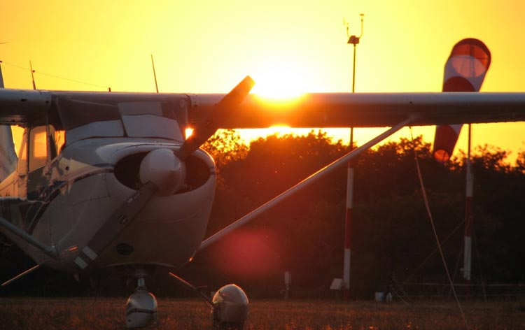 Cessna aircraft parked up with setting sun